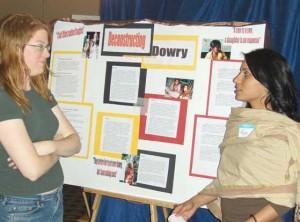 Rhea Muchalla ('09) talks with Thia Cooper (religion)
